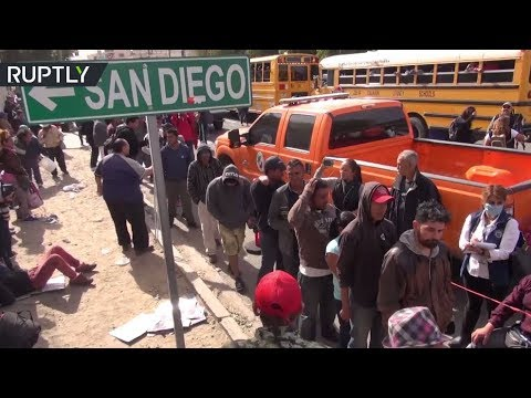 RAW: First migrants arrive at US-Mexico border