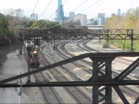 The rush hour beings on Metra's electrified former Illinois Central/ICG main line southbound out of Chicago, with CN's Chicago Subdivision next to it. The tr...