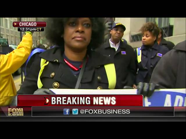 Protesters circle Chicago City Hall with caskets