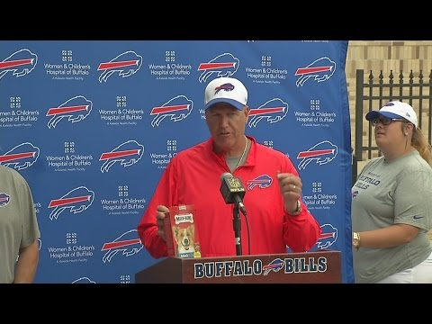 Rex Ryan, Terry Pegula munch on dog biscuits for a good cause