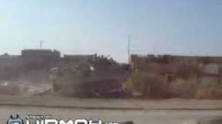 US tank crushes Iraq cars so they can