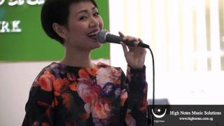 Joanna Dong performs vocal trumpet and sings 小城故事 Xiao Cheng Gu Shi at Raffles City Chinese New Year