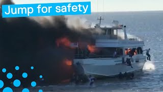 PASSENGERS LEAP INTO WATER FROM BURNING BOAT