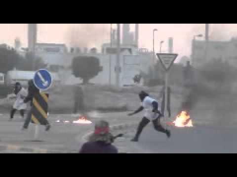 Bahrain: Violent anti-government protesters attack police.