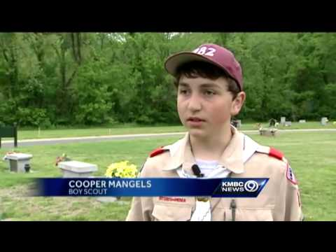 Scouts leave flags at veterans' graves