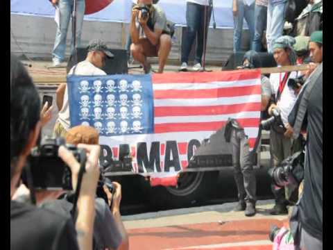 Protests Greet Obama in Manila as Defence Pact Signed....Thousands