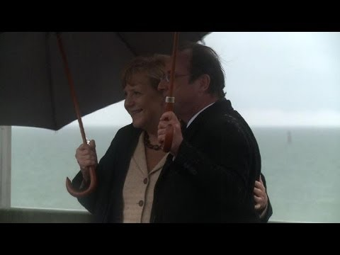 Hollande and Merkel hold meetings on German coast