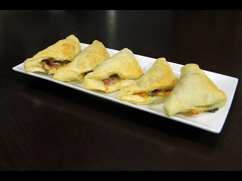Закуска слоеные треугольники