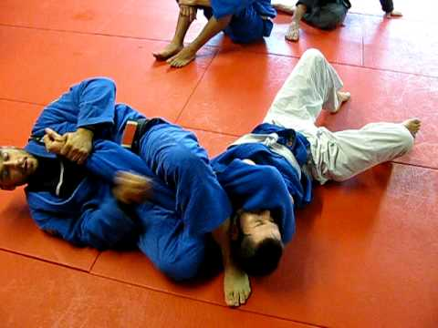 Open Guard sweep to arm bar Image 1