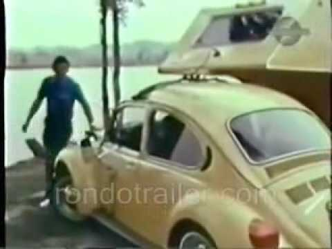 VW bug pulling a 5th wheel camper. Fun!