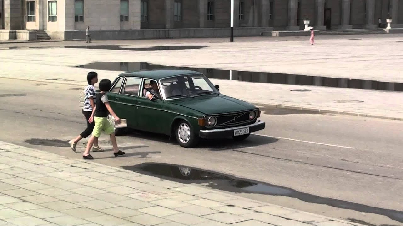 A Volvo 144 passing the Kim Il Sung square in Pyongyang - YouTube