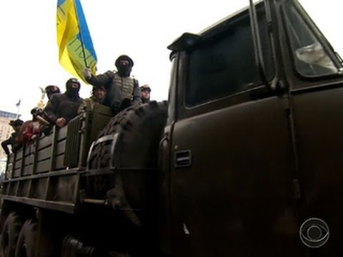 Ukrainian protestors claim victory after seizing capital