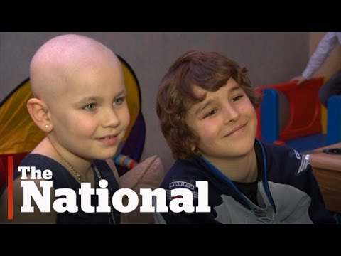 Boy gives hockey stick to cancer-fighting Winnipeg girl at Jets game