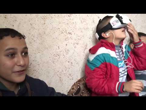 Children experience virtual reality gear in Gaza