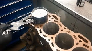 Installing a piston into a cylinder