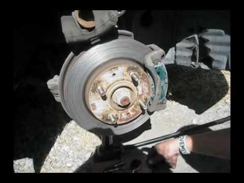 Замена тормозных колодок Mitsubishi Lancer 9, видео