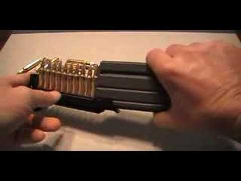 Loading AR-15 magazine with a maglula.