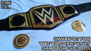 Changing out the side plates on a replica WWE World Heavyweight Championship