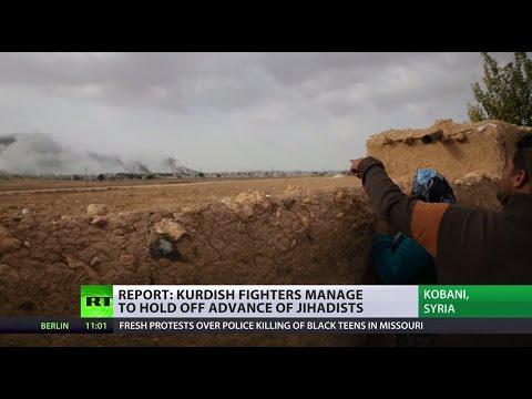 Enemy at the gates: Turkish war machine watches ISIS battle Kurds for Kobani