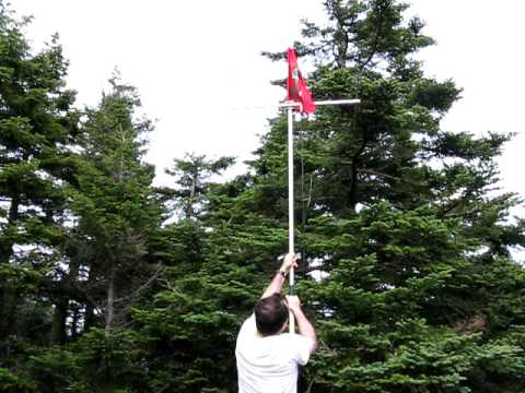 The official SOTA flag raising on the summit of Slide Mountain, W2/GC-001