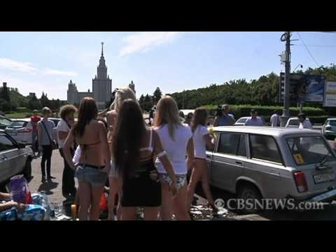 Russian girls tear off clothes to support Putin