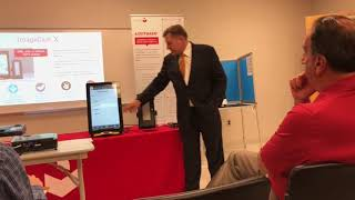 Dominion Voting Systems representative demonstrates voting machines