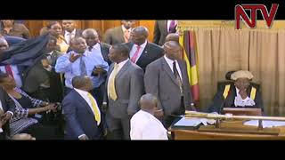 Brawl in Parliament as Opposition MPs accuse Hon. Ronald Kibuule of bringing a Gun into the House