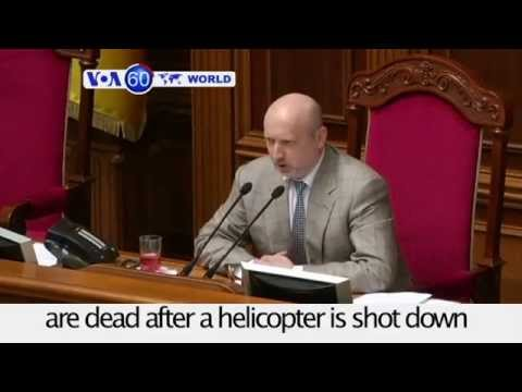 Acting Ukrainian president says 14 military personnel killed after a helicopter is shot down