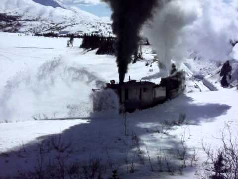 This video shows the operation of the historic steam locomotives and rotary snow plow of the White Pass & Yukon Route railway north of Skagway, Alaska, on April 27, 2011.