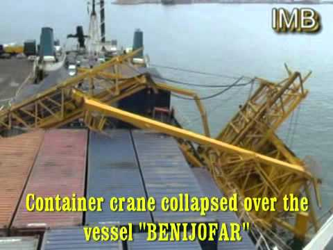 Container crane collapsed over the vessel