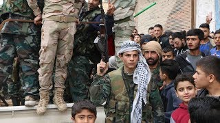 Cheering crowds welcome pro-government Syrian militias in Afrin