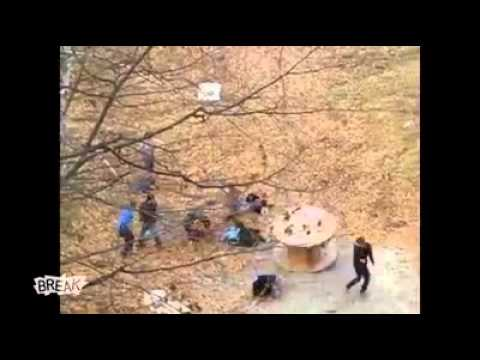 Two dudes rolling down a hill in a wooden wheel  What could go wrong