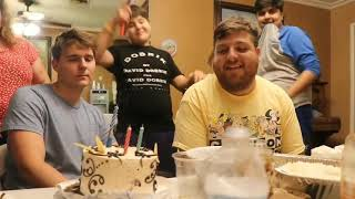 Alex in vlog squad blowing out the candles from birthday cake