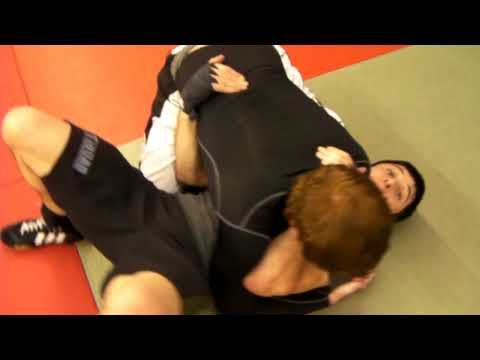 Escape from Side control into D'arce choke Image 1