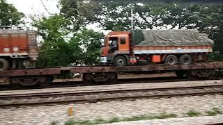 Indian Railways: transporting trucks on train