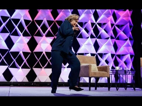 Woman throws a shoe at Hillary Clinton in LA at the Institute of Scrap Recycling Industries 4/10/14