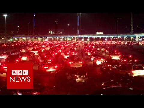 A day at the world's busiest land border - BBC News