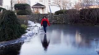 Walking & gliding on our thin, icy, glass-mirror, slippery pond
