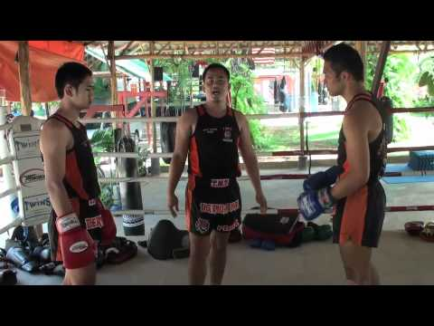 Tiger Muay Thai Techniques: Block/catch body kick and sweep opponent Image 1