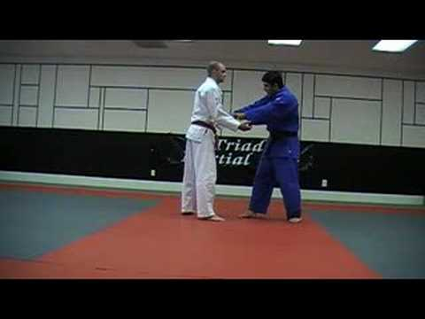 Judo: Sode Tsuri Komi Goshi - Sleeve lifting and pulling hip Image 1