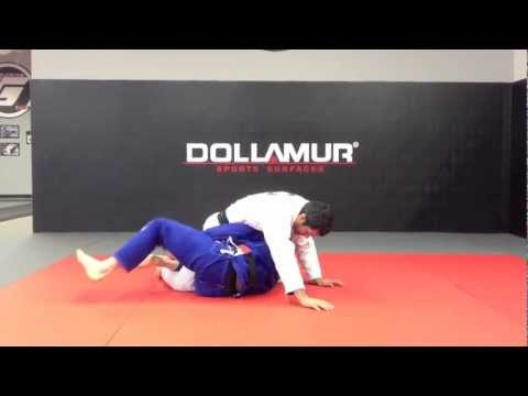 Guerrilla Tech of the Week - Deep Half Guard Hub - Straight Leg Sweep and Armlock Finish Image 1
