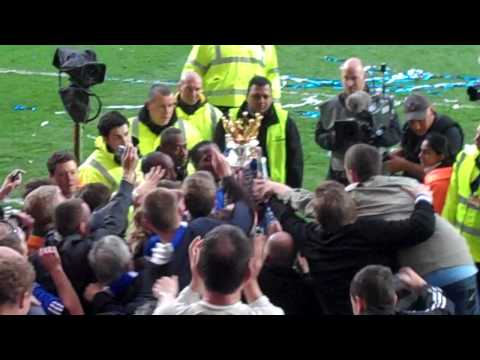 Didier Drogba brings Premiership trophy to the Matthew Harding stand