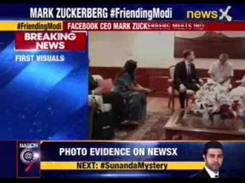 Dressed in dark suit, Facebook's Mark Zuckerberg meets PM Modi