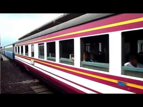 Passenger train arriving at Khlong Sipkao Junction Thailand