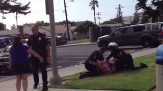US Cops beat woman in her children's eyes,  for allegedly belt violation