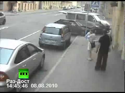 CCTV: Woman s narrow escape from car crash chaos
