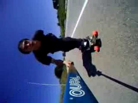 longboarder jumps off board and runs into guardrail