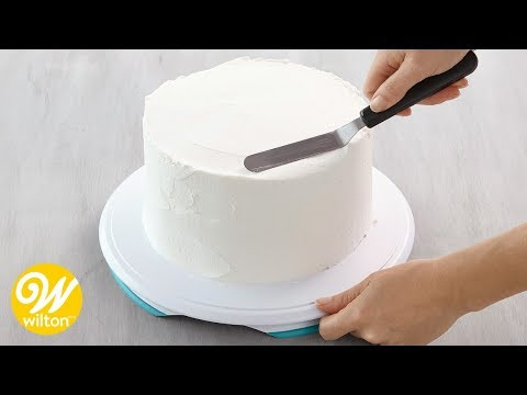How to Crumb Coat and Ice a Cake Using a Spatula | Wilton