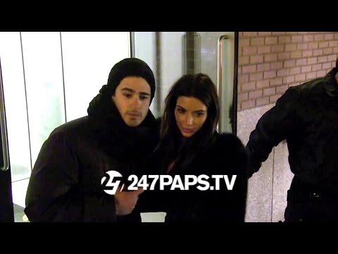 (Exclusive) Kanye West and Kim Kardashian kiss in NYC 02-17-14