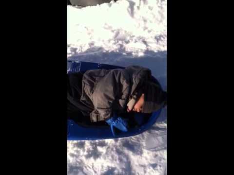 Rian asleep on the sled